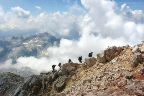 Hikers on the Julian Alps